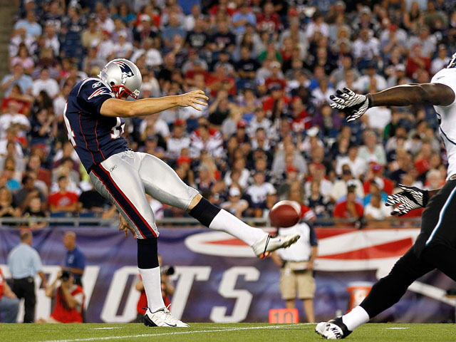 Zoltan Mesko #14 of the New England Patriots punts against the defense of Alvin Bowen #54 of the Jacksonville Jaguars during a preseason game at Gillette Stadium on August 11, 2011