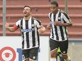 Udinese's Antonio Di Natale celebrates after scoring a late equaliser against Bologna on September 15, 2013