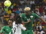 Augsburg striker Aristide Bance heads for goal while on international duty with Burkina Faso.