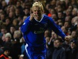 Eidur Gudjohnsen of Chelsea celebrates scoring the first goal during the UEFA Champions League Quarter Final match between Chelsea and Arsenal at Stamford Bridge on March 24, 2004