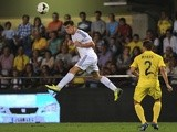 Real Madrid midfielder Gareth Bale heads the ball during his debut against Villarreal on September 14, 2013