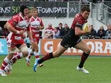 Saracens' Joel Tomkins races clear to score his team's first try during the match against Gloucester on September 15, 2013