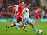 West Ham's Mark Noble and Southampton's Adam Lallana battle for the ball during their Premier League match on September 15, 2013