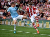 Stoke's Matthew Etherington and Manchester City's James Milner battle for the ball on September 14, 2013