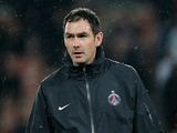 PSG coach Paul Clement leads a warm up prior to the Champions League match against Valencia on March 6, 2013