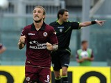 Livorno's Paulinho celebrates after scoring the opening goal against Calcio Catania on September 15, 2013