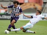 Toulouse's forward Martin Braithwaite vies with Marseille's defender Lucas Mendes during a game on September 14, 2013
