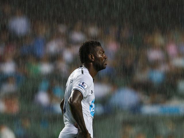 Emmanuel Adebayor of Tottenham Hotspur looks on through heavy rainfall during the Barclays Asia Trophy Semi Final match between Tottenham Hotspur and Sunderland at Hong Kong Stadium on July 24, 2013