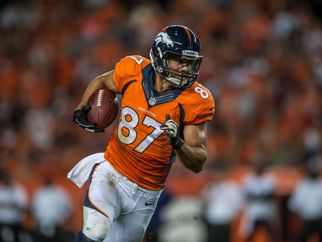 Wide receiver Eric Decker #87 of the Denver Broncos runs for yards after the catch against the Baltimore Ravensduring the game at Sports Authority Field at Mile High on September 5, 2013