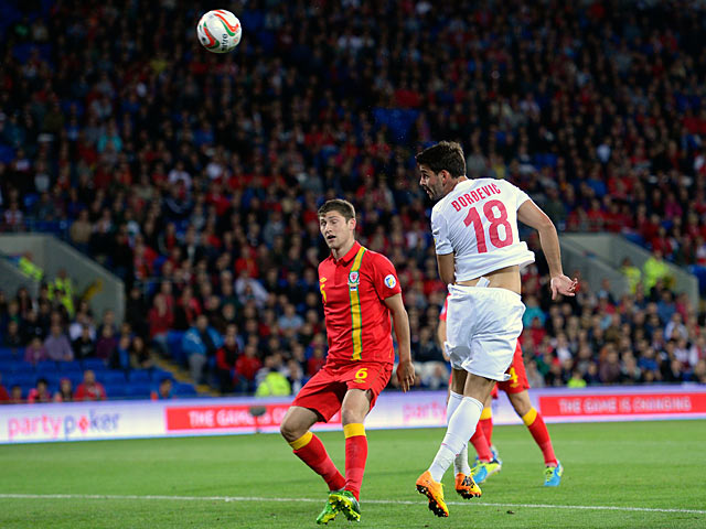 Serbia's Filip Dordevic heads in the opening goal against Wales during their World Cup qualifying match on September 10, 2013