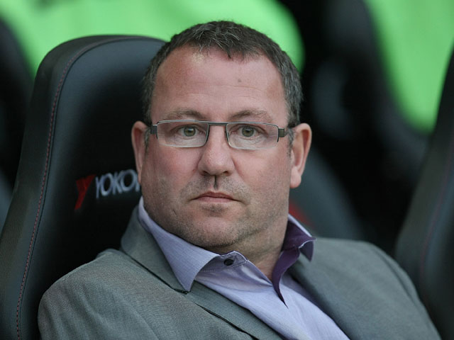 Carlisle United manager Greg Abbott looks on during the League One match between Milton Keynes Dons and Carlisle United at stadium mk on March 27, 2012