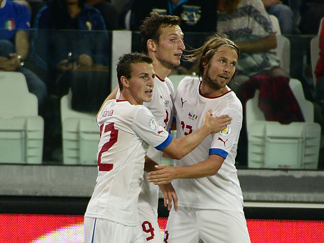 Czech Republic's Libor Kozak is congratulated by team mates after scoring the opening goal against Italy during their World Cup qualifying match on September 10, 2013