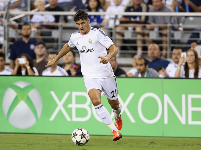 Álvaro Morata #21 of Real Madrid contorls the ball during the International Champions Cup match against the Los Angeles Galaxy at University of Phoenix Stadium on August 1, 2013