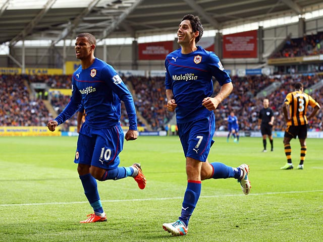 Cardiff's Peter Whittingham celebrates with team mate Fraizer Campbell after scoring the equaliser against Hull on September 14, 2013
