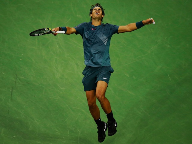 Rafael Nadal falls to the ground as he wins the US Open in New York on September 9, 2013