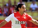 Monaco's Colombian forward Radamel Falcao celebrates after scoring a goal from the penalty spot during the French L1 football match between AS Monaco and FC Lorient at the Louis II Stadium in Monaco on September 15, 2013