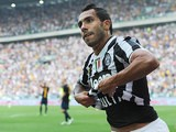 Juventus' Carlos Tevez celebrates after scoring the equaliser against Hellas Verona during their Serie A match on September 22, 2013