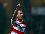 Doncaster's Chris Brown celebrates a goal against Watford on September 17, 2013