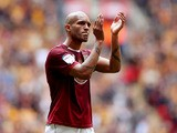 Clarke Carlisle looks dejected after defeat during the npower League Two Play Off Final between Bradford City and Northampton To