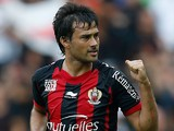 Nice's Dario Cvitanich celebrates after scoring the opening goal against Valenciennes during their Ligue 1 match on September 22, 2013
