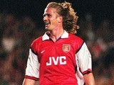 Arsenal midfielder Emmanuel Petit celebrates a goal against Nottingham Forest on August 17, 1998