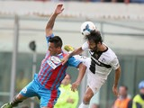 Catania's Fabian Monzon and Parma's Mattia Cassani battle for the ball during their Serie A match on September 22, 2013