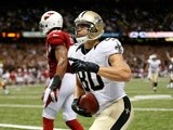 Saints' Jimmy Graham celebrates a touchdown against the Arizona Cardinals on September 22, 2013
