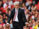 Stoke manager Mark Hughes on the touchline during his team's Premier League match against Arsenal on September 22, 2013