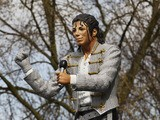 Fulham chairman Mohamed Al Fayed unveils a statue in tribute to Michael Jackson prior to the Barclays Premier League match between Fulham and Blackpool at Craven Cottage on April 3, 2011