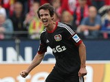 Leverkusen's Robbie Kruse celebrates after scoring his team's third goal against Mainz during their Bundesliga match on September 21, 2013