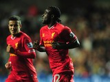Liverpool's Victor Moses celebrates after scoring his team's second goal against Swansea on September 16, 2013