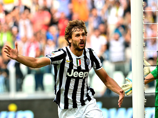 Juventus' Fernando Llorente celebrates after scoring his team's second goal against Hellas Verona during their Serie A match on September 22, 2013