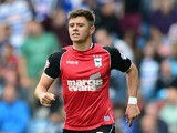 Aaron Cresswell of Ipswich in action during the Sky Bet Championship match between Queens Park Rangers and Ipswich Town at Loftus Road on August 17, 2013