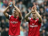 Welsh midfielder Aaron Ramsey and English midfielder Jack Wilshere acknowledge the crowd as they celebrate their victory after the final whistle in the English Premier League football match between Newcastle United and Arsenal at St James' Park in Newcast