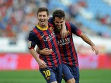 Lionel Messi of FC Barcelona celebrates with team-mate Cesc Fabregas after scoring the opening goal during the La Liga match between UD Almeria and FC Barcelona on September 28, 2013