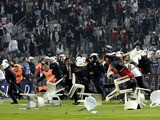 Besiktas football team supporters fight with Anti riot police officers during the Turkish super league football match Besiktas vs Galatasaray on September 22, 2013