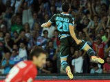 Napoli's Blerim Dzemaili celebrates after scoring the opening goal against Sassuolo Calcio during their Serie A match on September 25, 2013