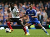 Buomesca Tue Na Bangna of Fulham looks to turn Ashley Cole of Chelsea during the Barclays Premier League match between Chelsea and Fulham at Stamford Bridge on September 21, 2013