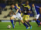Birmingham's Callum Reilly and Swansea's Dwight Tiendalli battle for the ball during their League Cup match on September 25, 2013