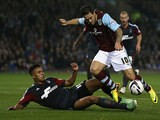 Burnley's Danny Ings and Nottingham Forest's Jamaal Lascelles battle for the ball during their League Cup match on September 24, 2013