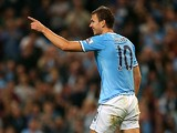 Man City's Edin Dzeko celebrates after scoring the opening goal against Wigan during their League Cup match on September 24, 2013