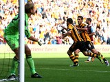 Robbie Brady of Hull City is congratulated by teammate Danny Graham #9 after scoring the opening goal from the penalty spot during the Barclays Premier League match between Hull City and West Ham United at KC Stadium on September 28, 2013
