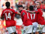 Wayne Rooney of Manchester United celebrates with team mates after scoring the Barclays Premier League match between Manchester United and West Bromwich Albion at Old Trafford on September 28, 2013
