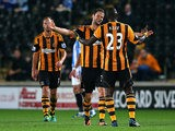 Hull's Nick Proschwitz celebrates with teammate Abdoulaye Diagne-Faye after scoring the opening goal against Huddersfield during their League Cup match on September 24, 2013