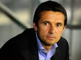 Lyon's French coach Remi Garde looks on during the UEFA Europa League football match Real Betis vs Olympique Lyonnais at the Benito Villamarin stadium in Sevilla on September 19, 2013.