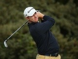Richard McEvoy plays a shot at The Open Championship on July 18, 2013