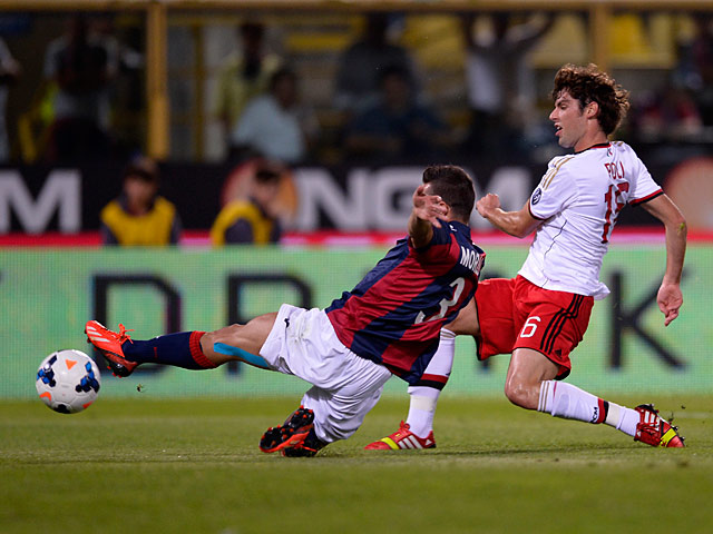 AC Milan's Andrea Poli scores the opening goal against Bologna during their Serie A match on September 25, 2013