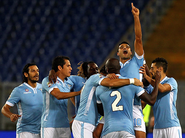 Lazio's Honorato Ederson is congratulated by teammates after scoring the opening goal against Catania during their Serie A match on September 25, 2013