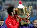 Novak Djokovic of Serbia poses for photographers after defeating Rafael Nadal of Spain during the final of the 2013 China Open at the National Tennis Center on October 6, 2013
