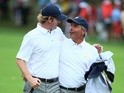 U.S. Team Captain Fred Couples (R) walks with Brandt Snedeker up the 18th hole during the Day Four Singles Matches at the Muirfield Village Golf Club on October 6, 2013